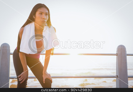 Breathing fit woman resting at promenade stock photo, Breathing fit woman resting at promenade on a sunny day by Wavebreak Media