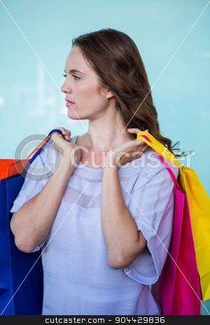 Pretty woman with shopping bags stock photo, Pretty woman with shopping bags on a sunny day by Wavebreak Media