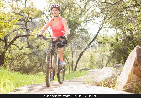 Blonde athlete mountain biking stock photo, Blonde athlete mountain biking in the nature by Wavebreak Media