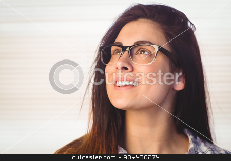 Pretty hipster looking up and smiling stock photo, Pretty hipster looking up and smiling in a bright room by Wavebreak Media