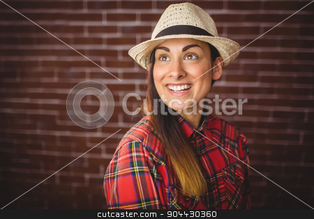 Beautiful hipster smiling stock photo, Beautiful hipster smiling on red brick background by Wavebreak Media