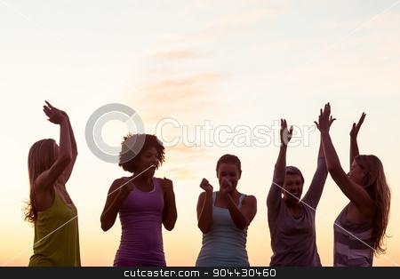 Happy sporty women cheering against sunset stock photo, Happy sporty women cheering against sunset in parkland by Wavebreak Media