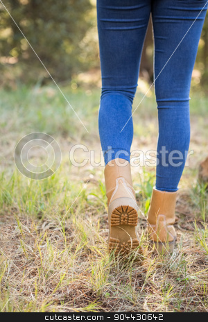 Close up view of woman hiking on path stock photo, Close up view of woman hiking on path in the nature by Wavebreak Media