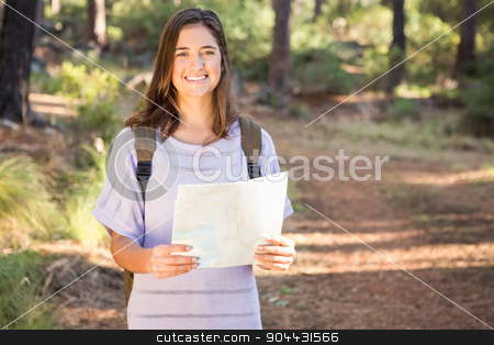 Pretty brunette hiker with map smiling stock photo, Portrait of pretty brunette hiker with map smiling in the nature by Wavebreak Media