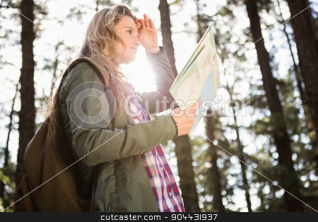 Pretty blonde hiker with map looking for path stock photo, Pretty blonde hiker with map looking for path in the nature by Wavebreak Media