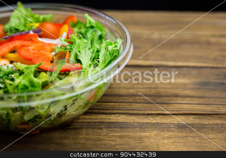 Healthy bowl of salad on table stock photo, Healthy bowl of salad on table shot in studio by Wavebreak Media