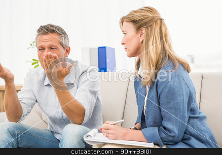 Therapist listening to male patients worries stock photo, Therapist listening to male patients worries in the office by Wavebreak Media