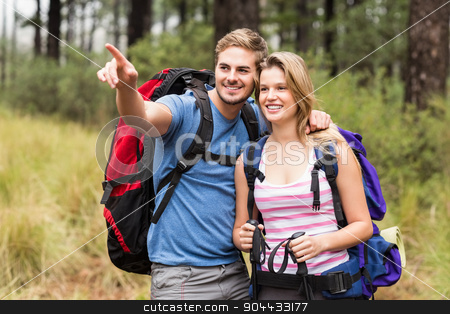 Young happy hiker couple pointing stock photo, Young happy hiker couple pointing in the nature by Wavebreak Media