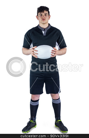 Rugby player holding a rugby ball stock photo, Portrait of a rugby player holding a rugby ball on a white background by Wavebreak Media