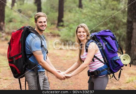 Young happy hiker couple holding hands stock photo, Young happy hiker couple holding hands in the nature by Wavebreak Media