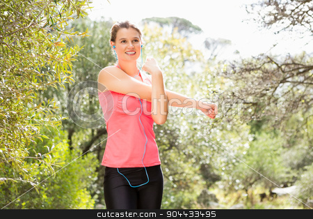 Smiling blonde athlete stretching arms stock photo, Smiling blonde athlete stretching arms in the nature by Wavebreak Media