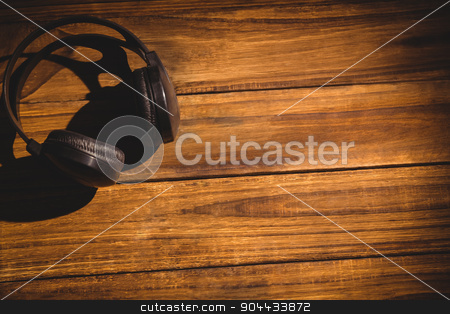 View of a desk stock photo, View of a desk with headphones by Wavebreak Media