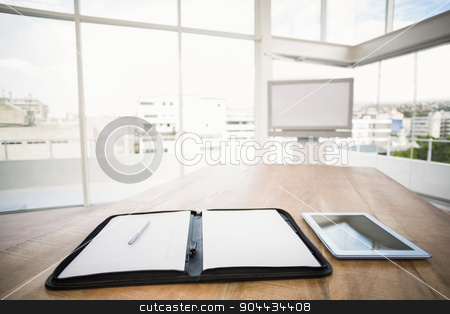 Tablet and planner in front of meeting room stock photo, Tablet and planner in front of meeting room in the office by Wavebreak Media