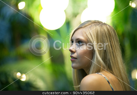Contemplative Blonde Woman stock photo, Contemplative young blonde woman under warm tungsten lighting. Shallow depth of field. by Todd Arena
