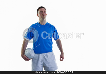 Rugby player holding a rugby ball stock photo, Portrait of a smiling rugby player holding a rugby ball by Wavebreak Media