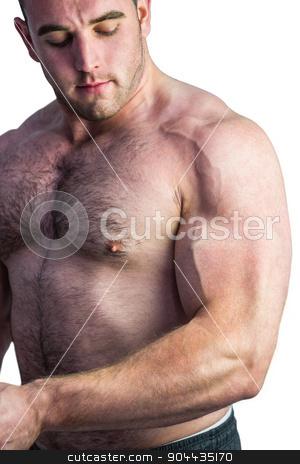 Strong bodybuilder flexing his bicep stock photo, Strong bodybuilder flexing his bicep on white background by Wavebreak Media