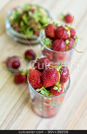 Strawberry stock photo, Fresh ripe strawberry in a glass by olinchuk
