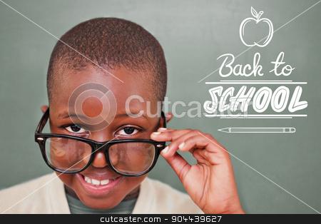 Composite image of cute pupil tilting glasses stock photo, Cute pupil tilting glasses against back to school by Wavebreak Media