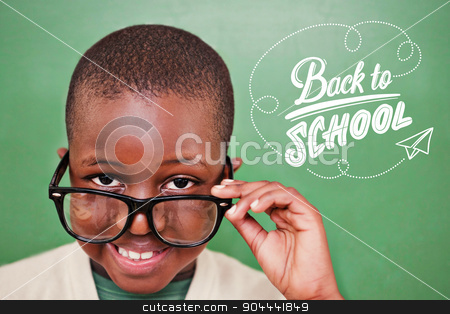 Composite image of cute pupil tilting glasses stock photo, Cute pupil tilting glasses against back to school by Wavebreak Media