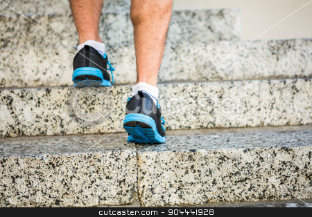 Athlete jogging up the stairs stock photo, Athlete jogging up the stairs in the city by Wavebreak Media
