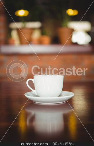Cup and saucer on the counter stock photo, Cup and saucer on the counter at coffee shop by Wavebreak Media