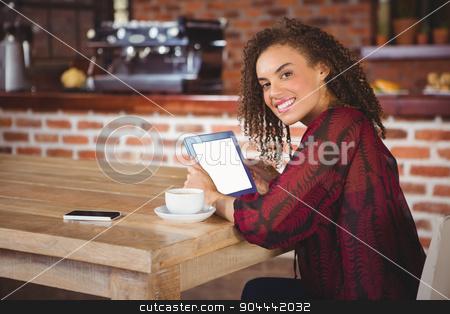 Woman using digital tablet stock photo, Woman using digital tablet in a cafe by Wavebreak Media