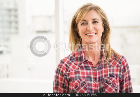 Casual businesswoman smiling to camera stock photo, Portrait of casual businesswoman smiling to camera in the office by Wavebreak Media