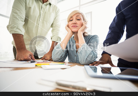 Exhausted businesswoman with eye closed stock photo, Exhausted businesswoman with eye closed at the office by Wavebreak Media