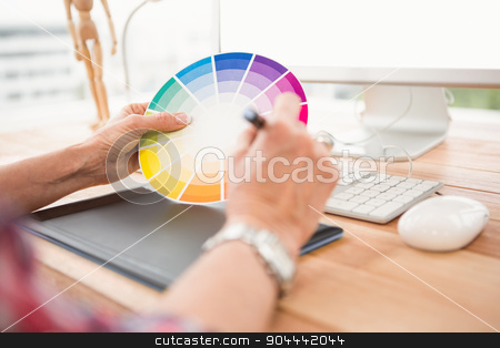 Close up view of hands working with digtizer and colour chart stock photo, Close up view of hands working with digtizer and colour chart in the office by Wavebreak Media