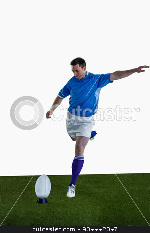 Rugby player doing a drop kick stock photo, Determined rugby player doing a drop kick by Wavebreak Media