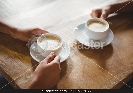 Close up of two cups of coffee stock photo, Close up of two cups of coffee on table by Wavebreak Media