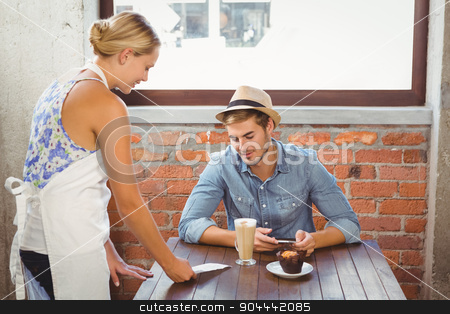 Blonde waitress showing bill to handsome hipster stock photo, Blonde waitress showing bill to handsome hipster at coffee shop by Wavebreak Media