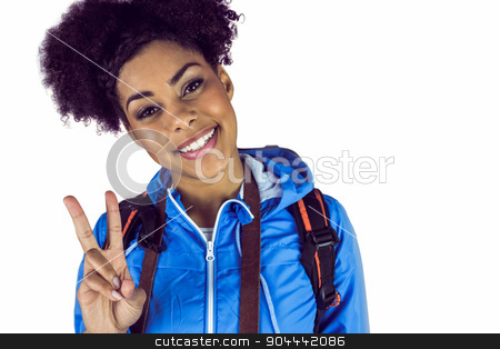 Young woman doing the peace sign stock photo, Young woman doing the peace sign against a white wall by Wavebreak Media