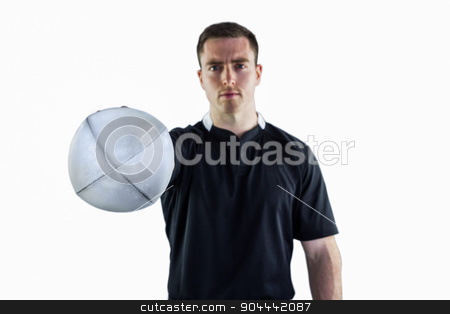Rugby player handing a rugby ball stock photo, Portrait of a rugby player handing a rugby ball by Wavebreak Media
