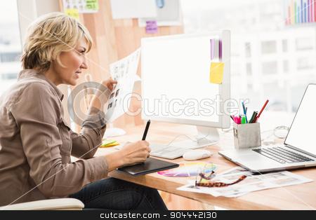 Casual designer editing photos stock photo, Casual designer editing photos in the office by Wavebreak Media