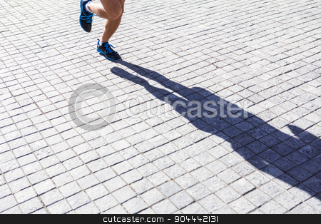 Close up view of athletes legs running stock photo, Close up view of athletes legs running in the city by Wavebreak Media