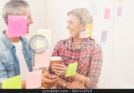 Casual business colleagues laughing at work stock photo, Casual business colleagues laughing at work in the office by Wavebreak Media