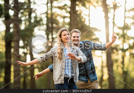 Smiling happy couple dancing stock photo, Portrait of smiling happy couple dancing in the nature by Wavebreak Media