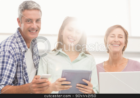 Casual business people with electronic devices stock photo, Portrait of casual business people with electronic devices in the office by Wavebreak Media
