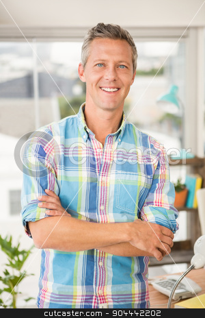 Smiling casual designer with arms crossed stock photo, Portrait of smiling casual designer with arms crossed in the office by Wavebreak Media
