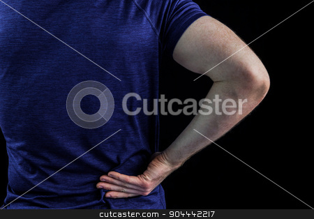 Rear view of a man with back pain over stock photo, Rear view of a man with back pain over over black background by Wavebreak Media