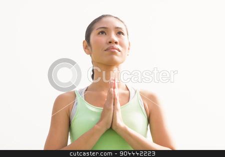 Focused sporty woman doing yoga stock photo, Focused sporty woman doing yoga in parkland by Wavebreak Media