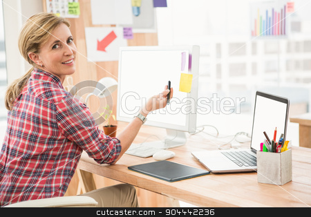 Smiling casual designer working with digitizer stock photo, Portrait of smiling casual designer working with digitizer in the office by Wavebreak Media