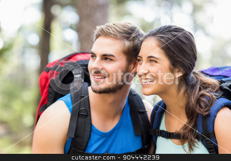 Young happy joggers looking at something in the distance stock photo, Young happy joggers looking at something in the distance in the nature by Wavebreak Media