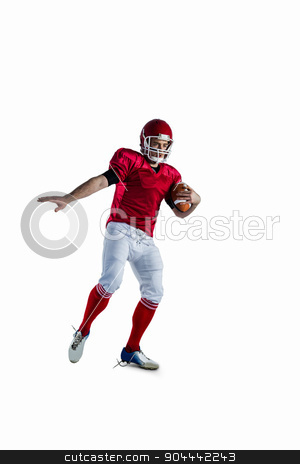 American football player protecting football stock photo, American football player protecting football against white background by Wavebreak Media