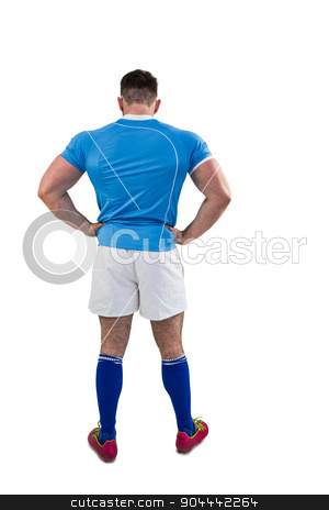 Rugby player with hands on hips stock photo, Rugby player with hands on hips on white background by Wavebreak Media