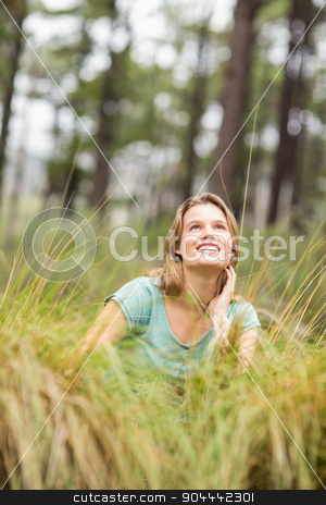 Young pretty hiker sitting in the high grass stock photo, Young pretty hiker sitting in the high grass in the nature by Wavebreak Media