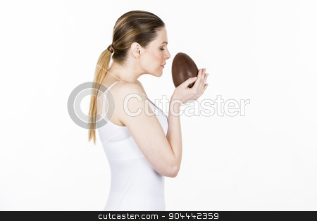 woman holding little chocolate easter egg stock photo, woman holding little chocolate easter egg by Flareimage