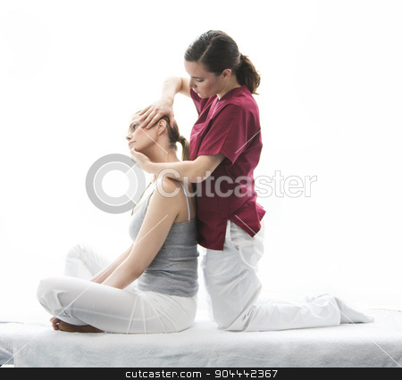 physical therapist  gets cervical evaluation  stock photo, physical therapist gets cervical evaluation  by Flareimage