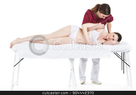 physiotherapist gets mobilisation of a shoulder to patient stock photo, physiotherapist gets mobilisation of a shoulder to patient by Flareimage